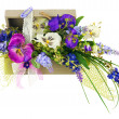 Bouquet from artificial flowers arrangement centerpiece in woode — Stock Photo #68848123