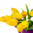 Yellow tulips in lilac vase isolated on white background. — Stock Photo #68848169