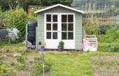 Wooden shed on an allotment garden — Stock Photo