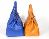 Blue and yellow handbags from genuine leather — Stock Photo