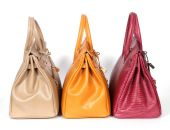 Beige yellow and purple genuine leather bags — Stock Photo