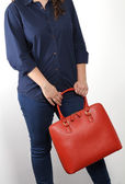 Young woman with genuine leather bag — Stock Photo