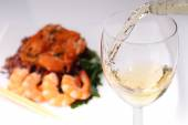 Pouring white wine and background — Stock Photo