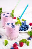 Milkshake with berries — Stock Photo