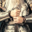 Knight wearing armor and holding sword — Stock Photo #52412173