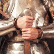 Knight wearing armor and holding sword — Stock Photo #52412177