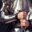 Knight wearing armor and holding sword — Stock Photo #52412203