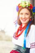 Woman wearing national ukrainian clothes outdoors — Stock Photo
