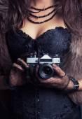 Woman holding vintage camera — Stock Photo
