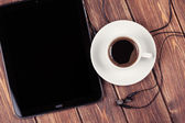 Empty tablet pc and a coffee — Stock Photo