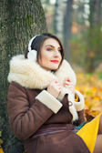 Woman enjoying a music — Stockfoto
