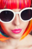 Woman wearing colorful wig — Stock Photo