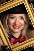 Cabaret woman with golden frame — Stock Photo