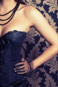 Woman wearing black corset and pearls — Stock Photo