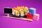 Maki sushi with blackboard and presents — Stock Photo