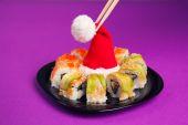 Maki sushi  with santa hat — Stock Photo