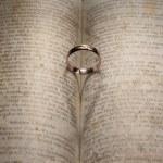 Wedding Ring  over a book — Stock Photo #63113103