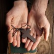 Hands holding vintage cross on Bible — Stock Photo #63113267