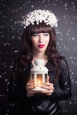 Woman in designer wreath holding  candle lamp — Stock Photo