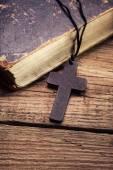 Christian cross on bible — Stock Photo