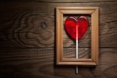 Lollipop heart on vintage frame — Stockfoto