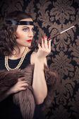 Retro woman holding mouthpiece — Stock Photo