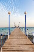 Wooden pier to open sea — Stock Photo
