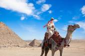 Bedouin seats camel — Stock Photo