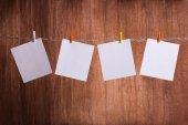 Four White blank notes — Stock Photo