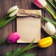 Colorful tulips with notepad — Stock Photo #71721563