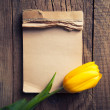 Yellow tulip with notepad — Stock Photo #71721623