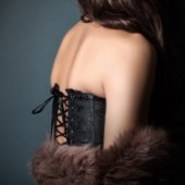 Woman wearing corset and fur — Stock Photo
