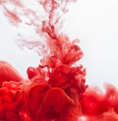 Red Inks in water — Stock Photo