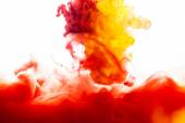 Yellow and red Inks in water — Stock Photo