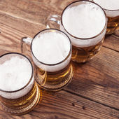 Top view of mugs of beer — Stock Photo