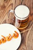 Shrimp grilled with glass of beer — Stock Photo