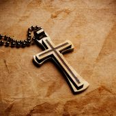 Cross on parchment paper — Stock Photo