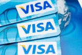 Pile of Visa cards on keyboard — Stock Photo