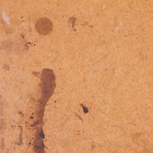 Old stained fiberboard texture — Stock Photo