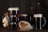Beer mugs and bottles — Stock Photo