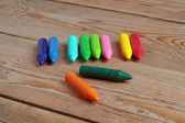 Crayons on a wooden table — Stock Photo