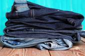 Stack of blue and dark blue jeans — Stock Photo