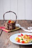 Plate and basket with colorful sweet candies — Stock Photo