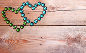Hearts on a wooden background — Stock Photo