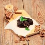 Chocolate bars with cinnamon and walnuts — Stock Photo #77394870