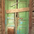 Crooked green door in old wooden house. — Stock Photo #57769435