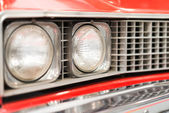 Close Up of Headlight of Red Classic Car — Stock Photo