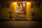Entry to old cafe at night in Vietnam, Asia. — Stock Photo