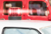 Flashing Red Siren Light on Roof of Vehicle — Stock Photo