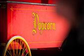 Vintage Style Yellow Popcorn Print on Red — Stock Photo
